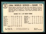 1965 Topps #134   -  Mickey Mantle / Barney Schultz / Tim McCarver 1964 World Series - Game #3 - Mantle's Clutch HR Back Thumbnail