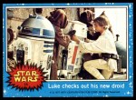 1977 Topps Star Wars #14   Luke checks out his new droid Front Thumbnail